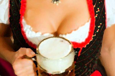 Girl holding glass of beer
